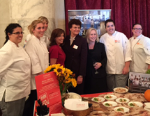 Culinary students pose in a picture with President Terenzio and Senator Kirsten Gillibrand