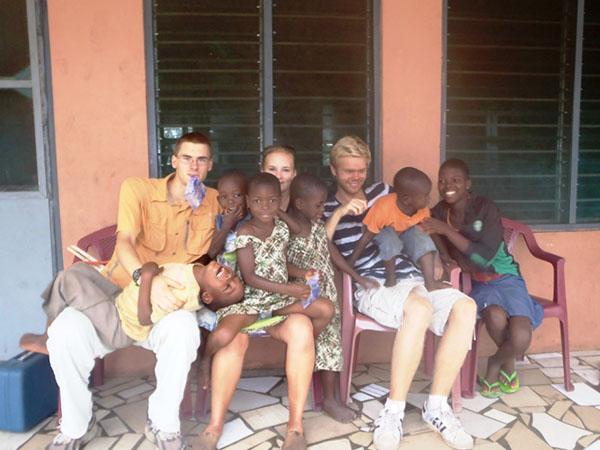 Student Marten Peterson volunteers with kids in Ghana.