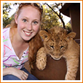 student with tiger in South Africa