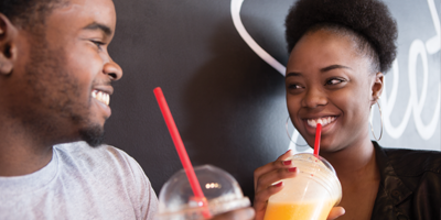 two students smiling in the cafe with smoothies